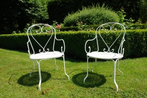 Pair French wrought iron armchairs