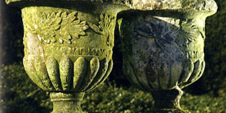 A pair of carved stone urns