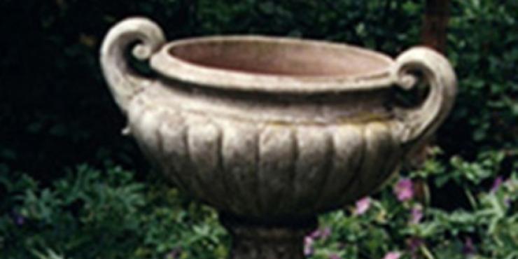 Antique garden urn on plinth, 19th century