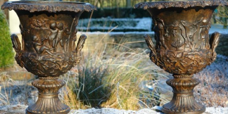 Pair cast iron Handyside garden urns
