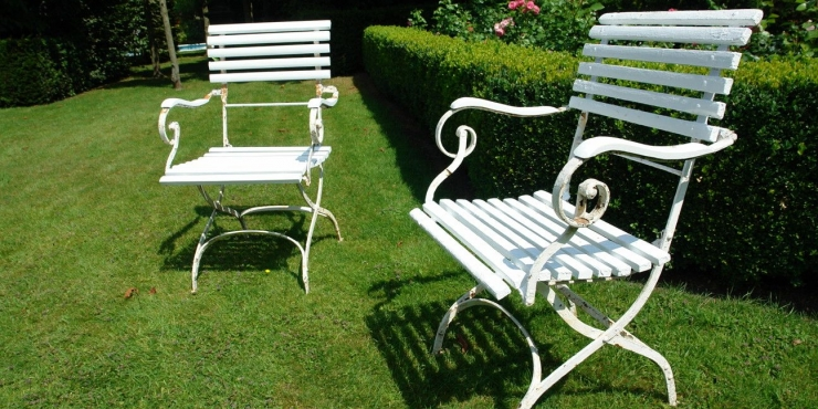 A pair of late 19th century garden armchairs