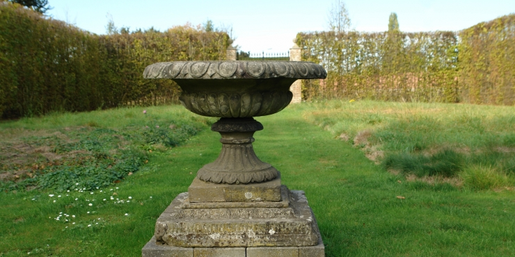 A 19th century fountain vase in composition stone