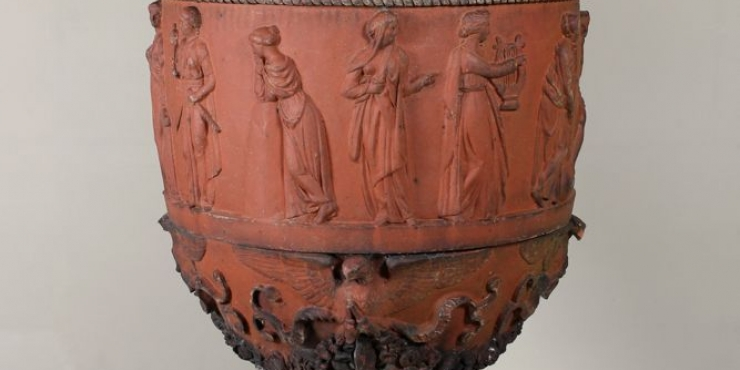 A large- scale terracotta garden urn