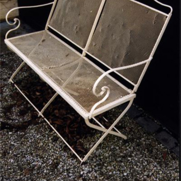 A 19th century French wrought iron garden bench