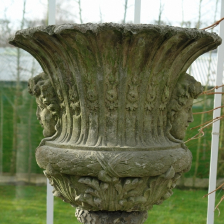 An early 20th century Janus face- urn