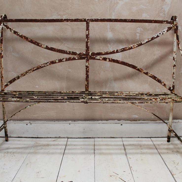 A wrought iron garden seat
